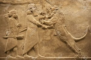 5710593-old-relief-representing-an-assirian-warrior-hunting-lions-stock-photo